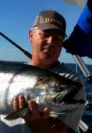 A happy Lake Ontario Fishing charter client.