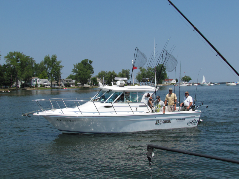 Our charter fishing boat had an awesome day fishing and is heading into the Oswego Marina.