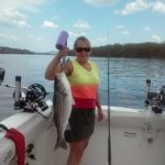 women caught this striper with Ace Charters