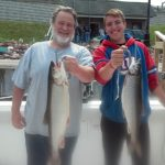 happy father and son fishing aboard Ace Charters