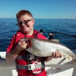 young kid with lake trout
