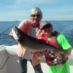 mother and son holding 12 lb lake trout