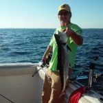 happy angler with Ace Charters on the water
