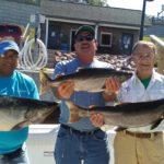 three happy anglers