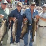 four guyss holding four king salmon