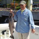 older gent holding king salmon