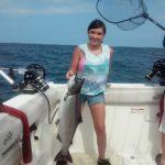 young girl with Lake Ontario king salmon