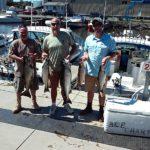 Three guys with king salmon