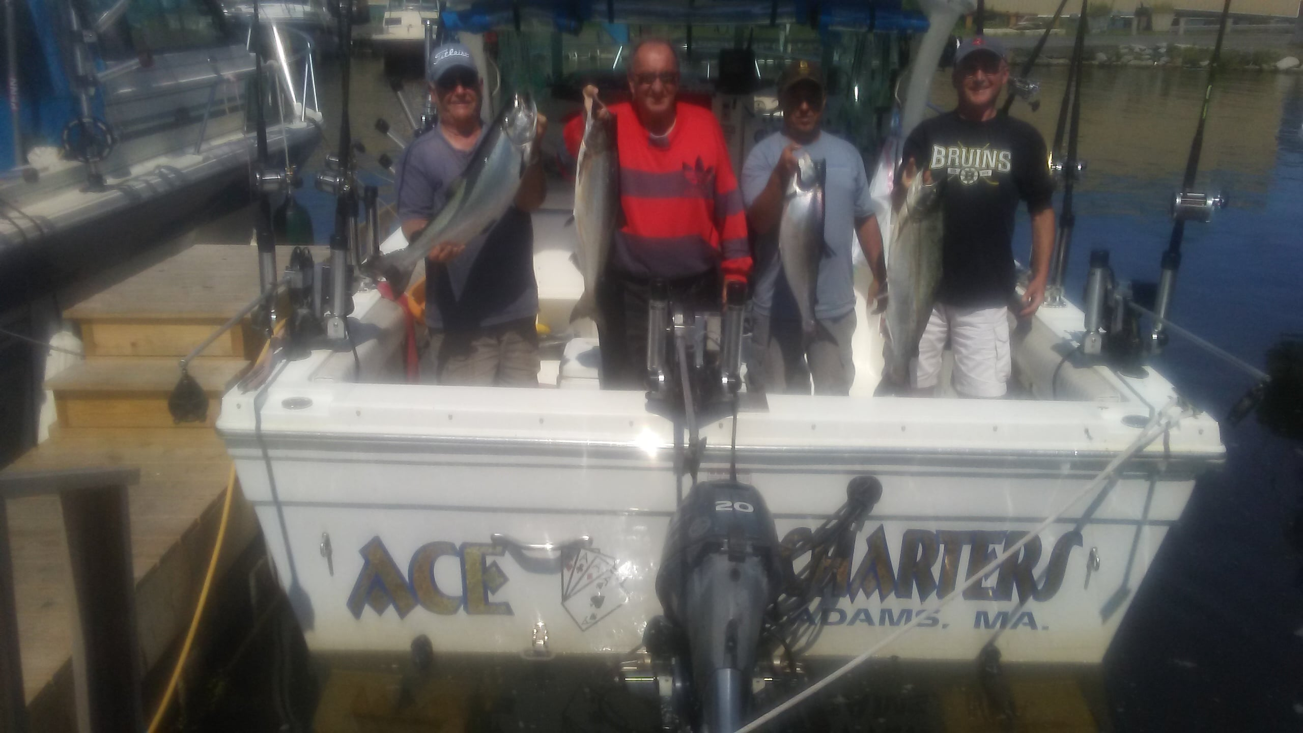 four men on back of Ace Charters with kings