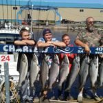 father and sons with limit of king salmon