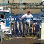 father and son with limit of kings with Ace Charters